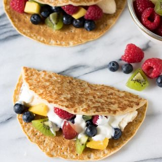 Crepes stuffed with yogurt and fruit to look like tacos.