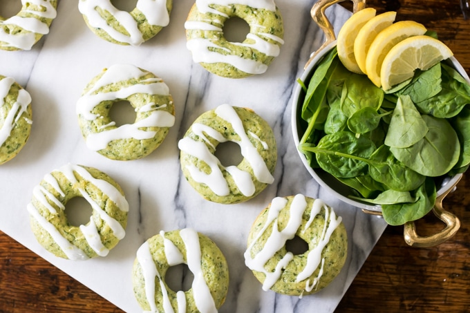 Spinach donuts on a marble board.