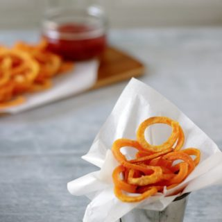 Spiralized fries in a pot.