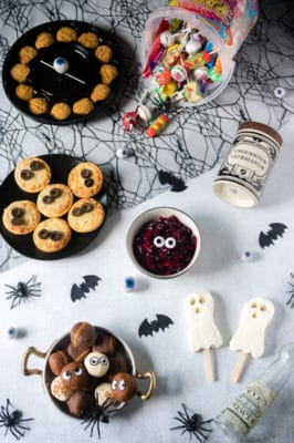 Iceland Party Food for Halloween including mini pizza with olive eyes, ghost ice lollies and profiteroles.