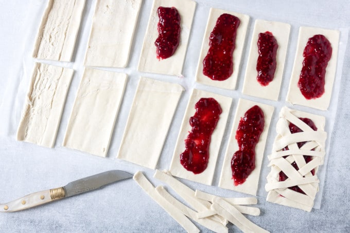 Puff pastry cut into rectangles and spread with raspberry jam.