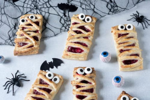A fun halloween recipe: rectangles of puff pastry spread with a quick raspberry puree (or raspberry jam), with strips of pastry on top to look like mummies. Add store-bought edible eyes to make them even more spooky and fun. Get the recipe at veggiedesserts.co.uk