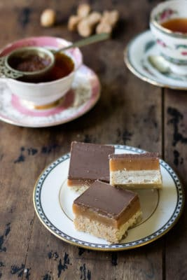 Millionaire Shortbread Recipe: Bottom layer of Rooibos infused shortbread, layer of rooibos infused caramel and milk chocolate on the top. It's easy and delicious.