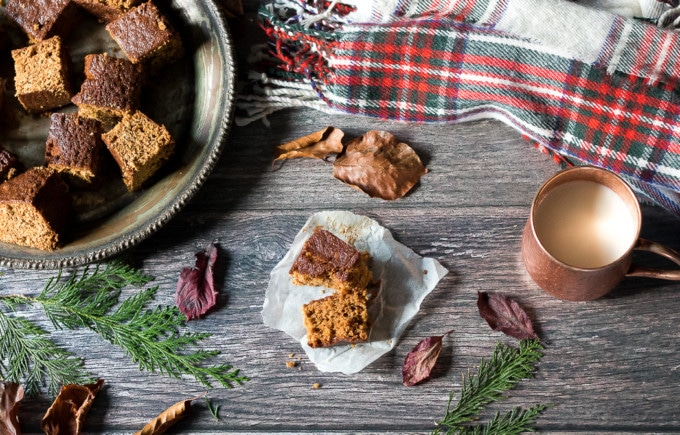 This Yorkshire Parkin recipe shown on a wooden table with leaves and a plaid scarf