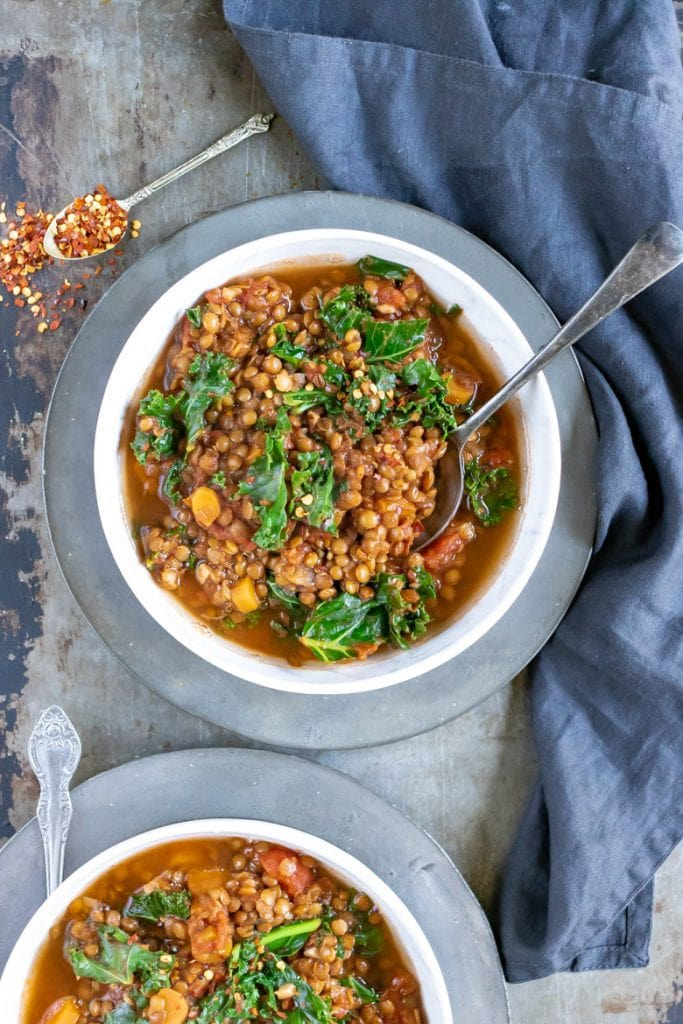 Overhead shot of two bowls of easy slow cooker lentil stew (vegan recipe).