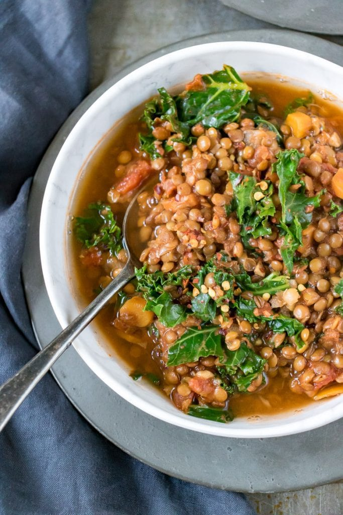 Close up overhead shot of a bowl of hearty Lentil Stew (vegan).