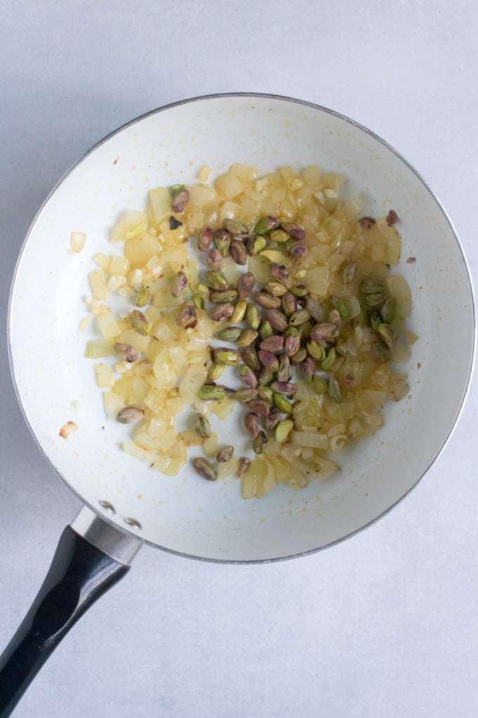 Tagliatelle with Creamy Pistachio Sauce (vegan). Step 1: fry onions, garlic and pistachios.