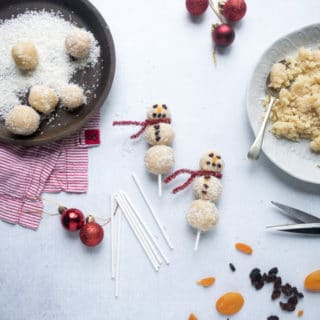 Easy no-bake vegan almond coconut bliss balls are threaded onto sticks to make fun Christmas snowmen. A fun festive healthy treat for kids.