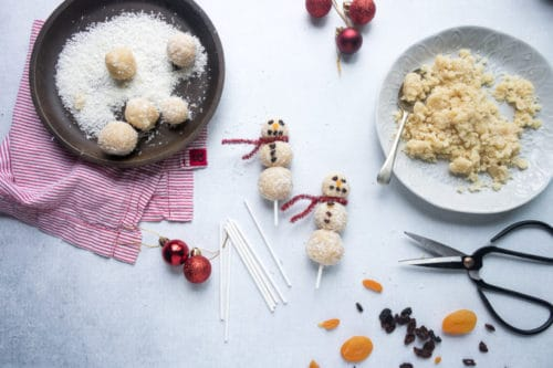 Easy no-bake vegan almond coconut bliss balls are threaded onto sticks to make fun Christmas snowmen. A fun festive healthy treat for kids.