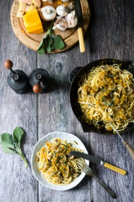 Pasta with mushrooms, grated butternut squash and sage butter. This easily vegan dish is a perfect Autumn comfort food. Get the recipe at VeggieDesserts.co.uk