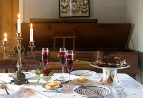 A table setting with Iceland Foods' luxury desserts and sparkling mulled wine cocktails.