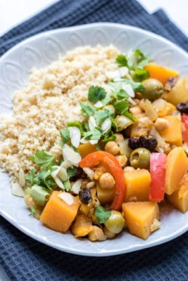 Butternut squash, olives, apricots and spices all mingle in this quick and easy vegetable tagine that's vegan and gluten-free.