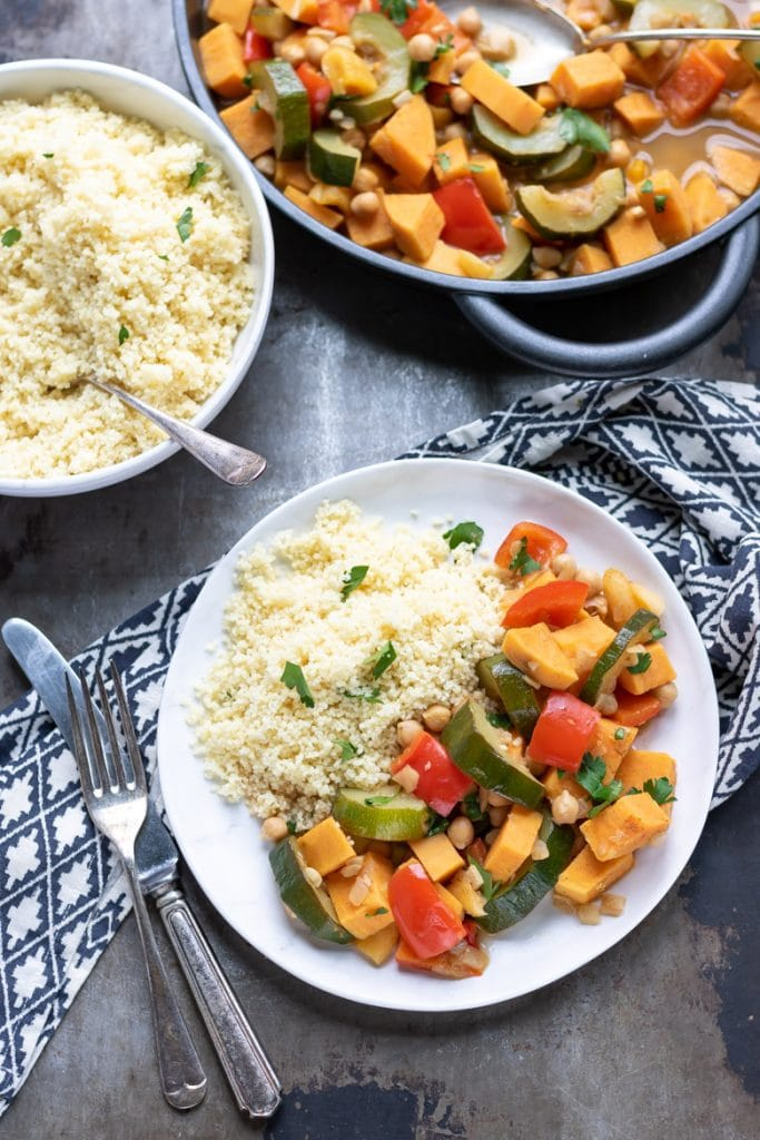 A plate of couscous and vegan vegetable tagine.