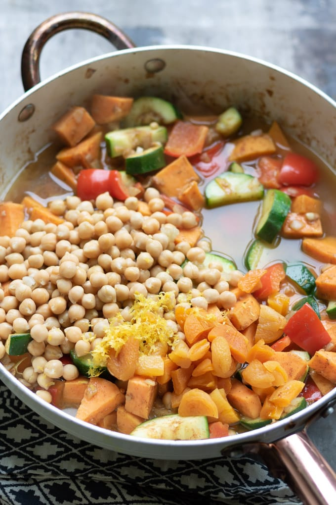 vegetables and chickpeas in a pan cooking