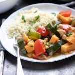 Plate of Moroccan vegetable tagine with couscous, with text overlay for Pinterest