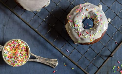 Irish cream infused chocolate doughnuts covered in Irish cream glaze and topped with sprinkles