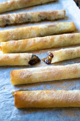 Mince Pie Filo Cigars are a lighter way to enjoy the flavours of mince pies. The mincemeat has chopped apples and pears and then it's all rolled in filo pastry and sprinkled with cinnamon sugar.