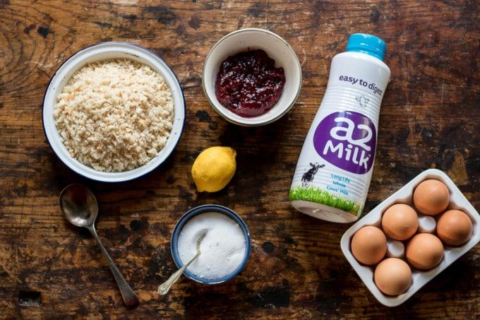 Ingredients to make Queen of Puddings: Milk, eggs, breadcrumbs, sugar, lemon, raspberry jam