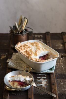 This easy Queen of Puddings recipe is a simple way to make the traditional British pudding. Layers of breadcrumb custard, raspberry jam and pillowy meringue all come together in a delicious dessert.