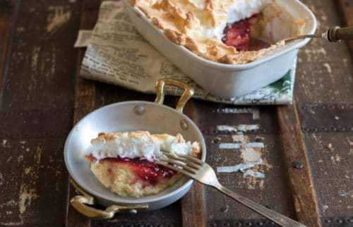 Queen of Puddings Recipe - a traditional British dessert made with breadcrumbs, custard, jam and meringue.