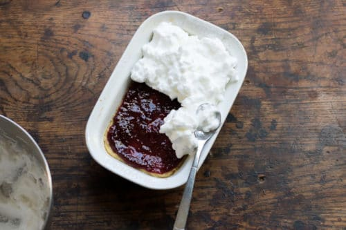 How to Make Queen of Puddings. Step 4: Beat the egg whites and remaining sugar until stiff and glossy. Spoon onto the jam, right to the edges, and use the back of a spoon to create swirls and peaks. Sprinkle with the remaining 1 tsp of sugar.