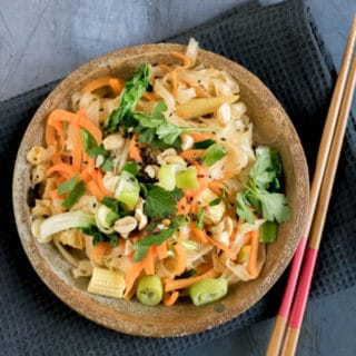 This tasty vegan Pad Thai is ready in just 15 minutes! It's full of flavour and fresh veggies with a little chilli kick and crunchy peanuts. Made with rice noodles, it's also gluten free.