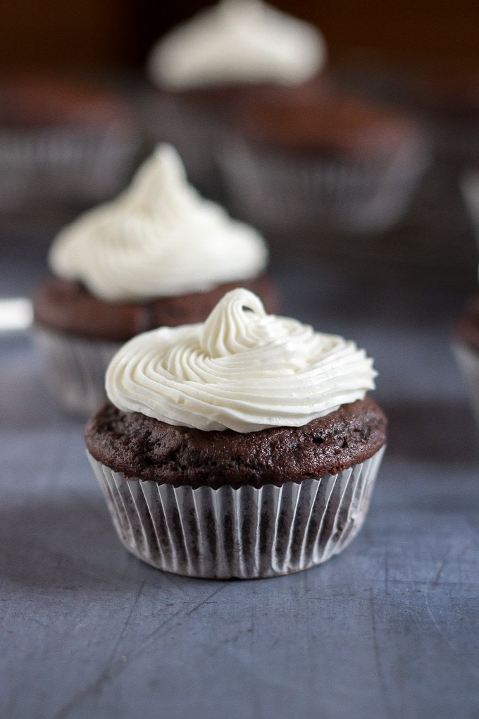 Close up of an easy vegan chocolate cupcake with vanilla frosting