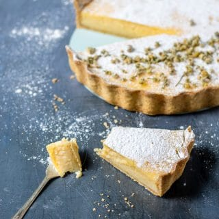 Lemon tart with chamomile tea pastry crust and a dusting of chamomile-infused powdered sugar
