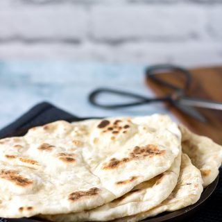 A stack of light and fluffy, quick and easy naan bread - yeast free.