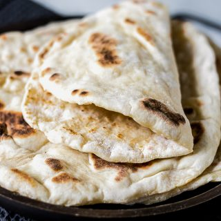 A folded fluffy yeast-free naan bread. Quick and easy to make.