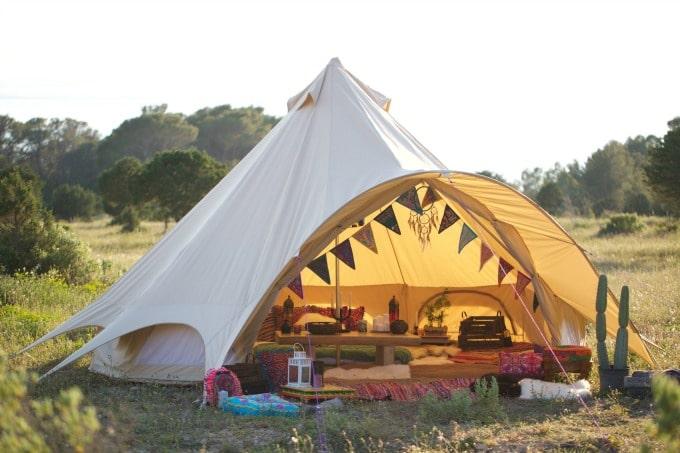 A tent in a field.