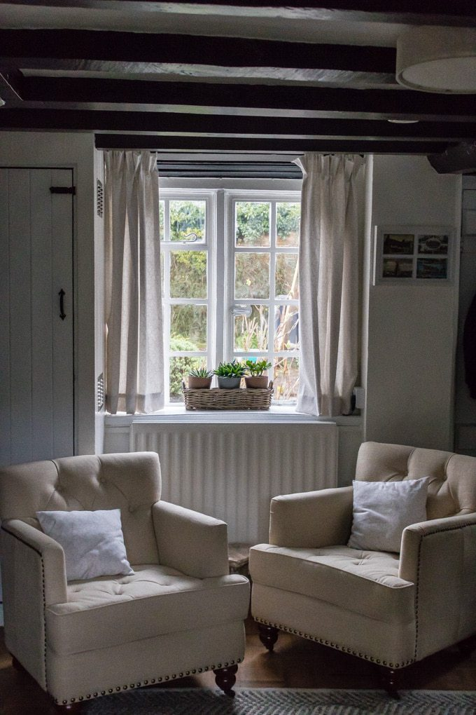 Two armchairs in front of window.