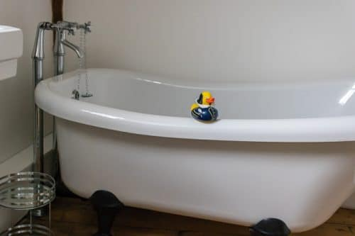 Roll top bathtub with Shakespeare rubber duck at One Masons Court, Stratford upon Avon