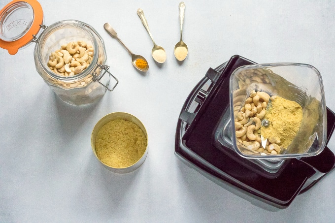 How to make vegan parmesan - step 1: blender with cashews, nutritional yeast, spices