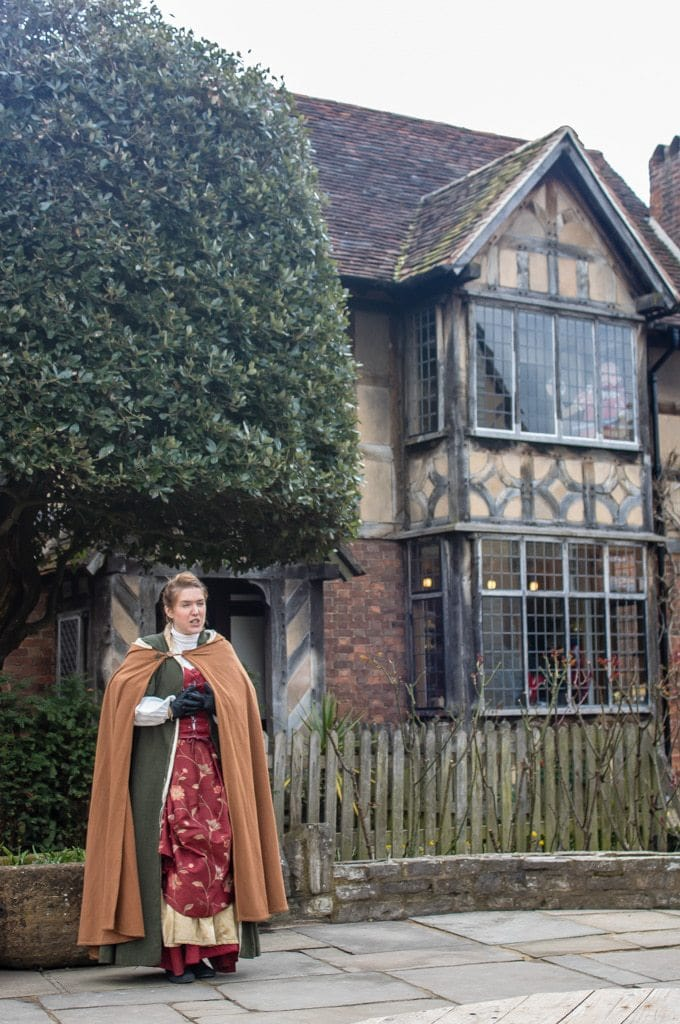 Actor outside Shakespeare's Birthplace in Stratford-Upon-Avon