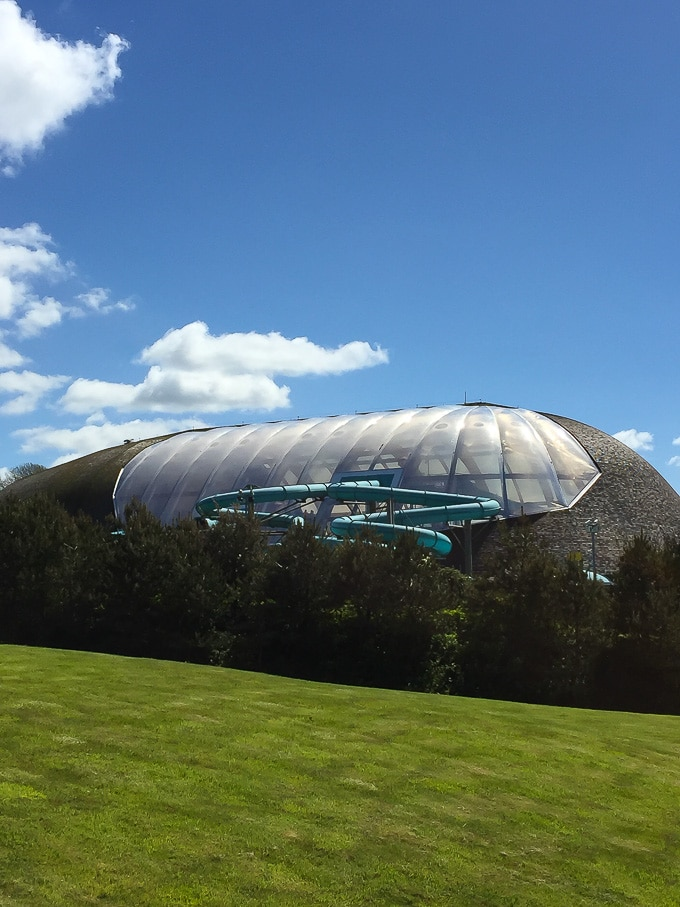Outside of the Blue Lagoon at Bluestone Wales, with waterslides coming out of the transparent dome.