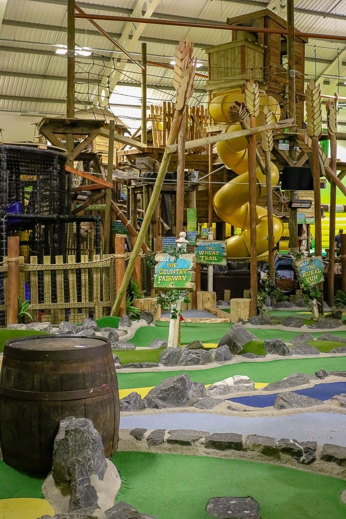 Bluestone Wales Review - inside the adventure centre with mini golf, climbing frames and more.