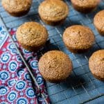 Healthy bran muffins cooling on a vintage rack on a blue background