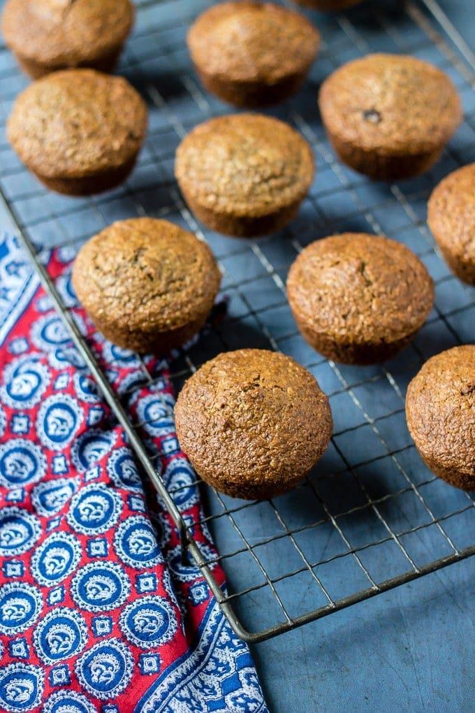 Muffins cooling on a vintage rack.