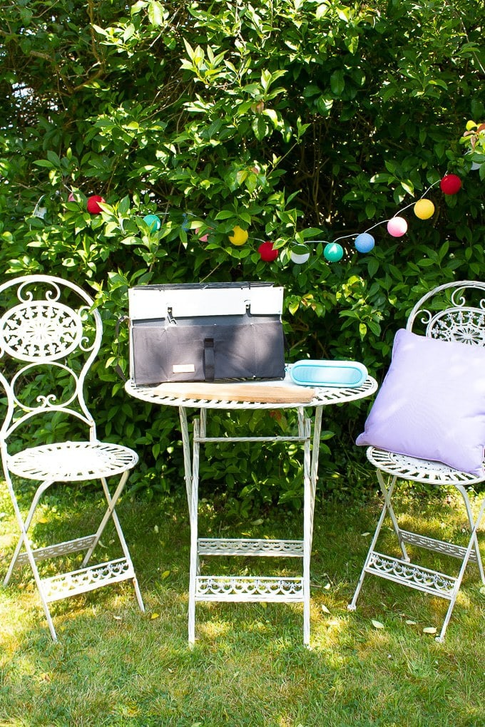 Glamping accessories guide - Outdoor seating with fairy lights, stove, speaker, cushion