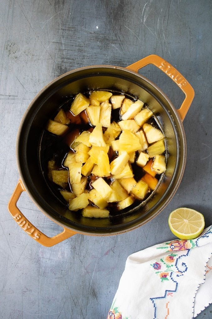 How to make pineapple compote - step 3: Reduce the heat, add the pineapple chunks and simmer for 15 minutes to reduce slightly.