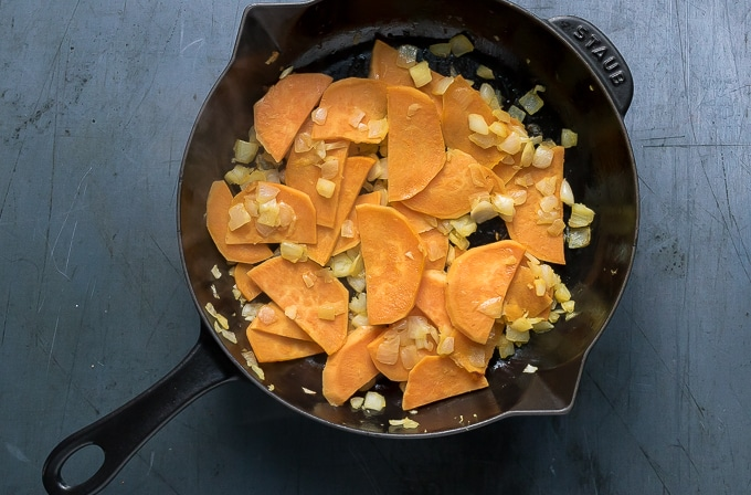 How to make sweet potato frittata: step 2 - cook the onion and sweet potato until soft and golden