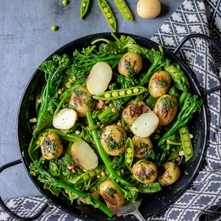 A bowl of fresh, healthy and tasty broccoli salad with peas, potatoes and herb dressing. Vegan, dairy free, gluten free.