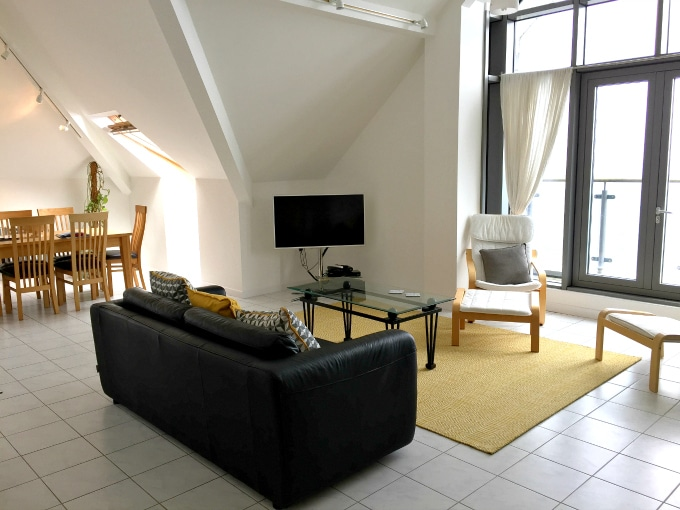 Interior of open plan living area in Gylly Sunrise apartment - self catering Falmouth Cornwall
