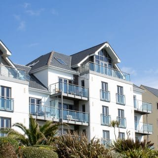 The exterior of Gylly Sunrise - self catering penthouse apartment in Falmouth, Cornwall. Bookable through Classic Cottages.