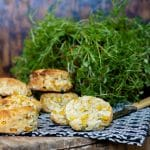 Corn and jalapeno scones with goat's cheese on a vintage crate with antique knife and pot of thyme