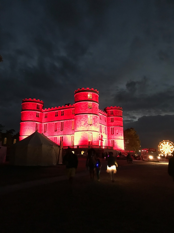 Lulworth Castle lit up red at Camp Bestival 2018