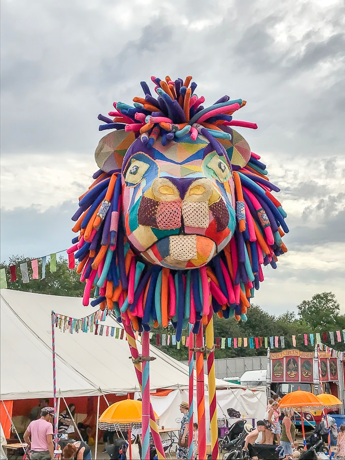 Fabric patchwork lion head outside the soft play at Camp Bestival 2018