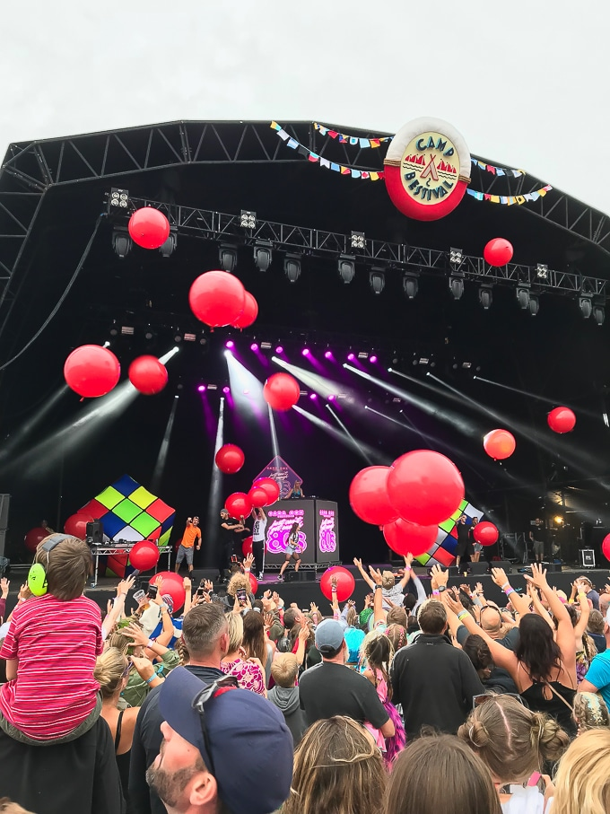 Giant red balloons being released over the crowd during Sarah Cox's 80s DJ set at Camp Bestival 2018