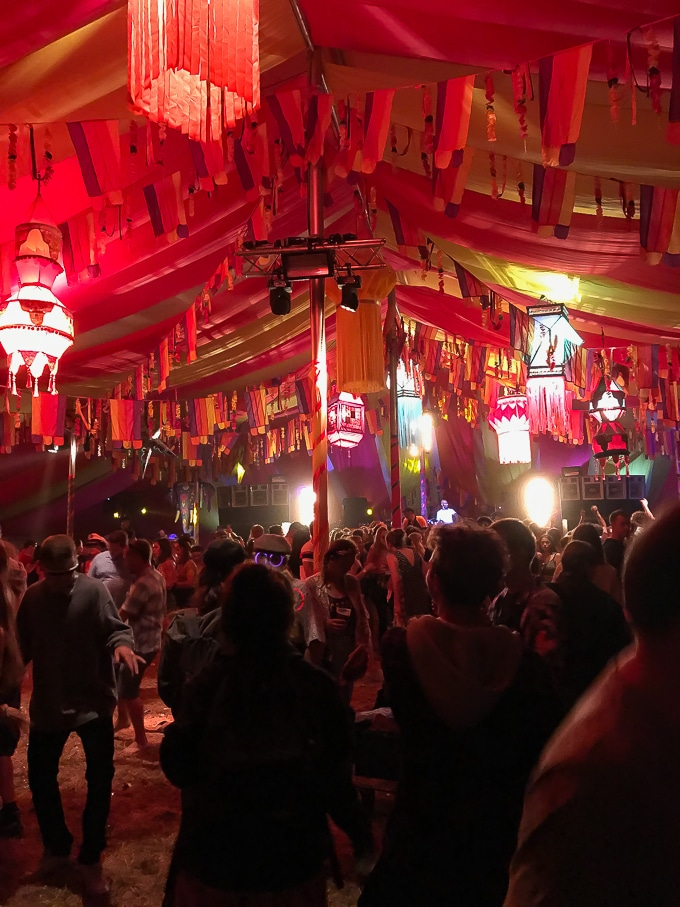Partying in brightly coloured the Bollywood tent - Camp Bestival Review 2018